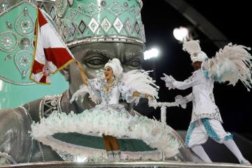 A dancer from the Mocidade Alegre samba school performs during a carnival parade in Sao Paulo, Brazil, Sunday, Feb. 7, 2016. (AP Photo/Andre Penner)
