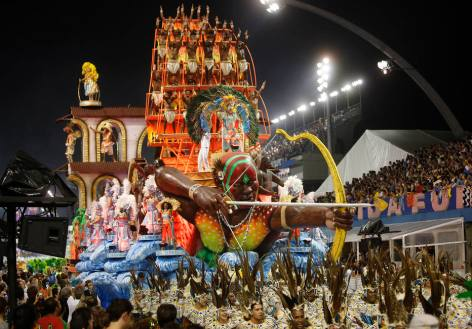 Dancers from the Unidos da Vila Maria samba school perform on a float during a carnival parade in Sao Paulo, Saturday, Feb. 6, 2016. (AP Photo/Andre Penner)